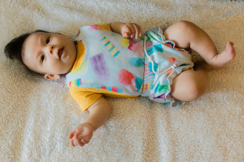 3 month old in popsicle overalls and mustard shirt