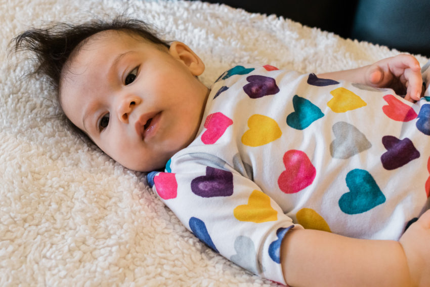 4 month old in colorful heart dress